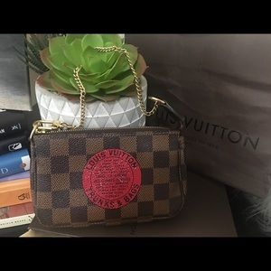 Authentic Louis Vuitton Damier Ebene Mini Pochette